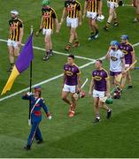 30 June 2019; Wexford joint captains Lee Chin, left, and Matthew O'Hanlon lead their side during the parade ahead of the Leinster GAA Hurling Senior Championship Final match between Kilkenny and Wexford at Croke Park in Dublin. Photo by Daire Brennan/Sportsfile