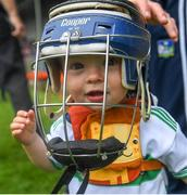 30 June 2019; Limerick supporter Thomas Quaid, age 18 months, son of Tommy Quaid, Limerick minor hurling selector, and nephew of Limerick senior goalkeeper Nickie Quaid, tries on a helmet at the Munster GAA Hurling Senior Championship Final match between Limerick and Tipperary at LIT Gaelic Grounds in Limerick. Photo by Piaras Ó Mídheach/Sportsfile