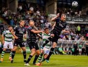 28 June 2019; Chris Shields of Dundalk in action against Lee Grace of Shamrock Rovers during the SSE Airtricity League Premier Division match between Shamrock Rovers and Dundalk at Tallaght Stadium in Dublin. Photo by Ben McShane/Sportsfile