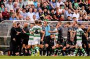 28 June 2019; Referee Robert Harvey issues a yellow card to Trevor Clarke of Shamrock Rovers after a challenge on John Mountney of Dundalk during the SSE Airtricity League Premier Division match between Shamrock Rovers and Dundalk at Tallaght Stadium in Dublin. Photo by Ben McShane/Sportsfile