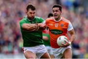 29 June 2019; Stefan Campbell of Armagh in action against Aidan O'Shea of Mayo during the GAA Football All-Ireland Senior Championship Round 3 match between Mayo and Armagh at Elverys MacHale Park in Castlebar, Mayo. Photo by Ben McShane/Sportsfile