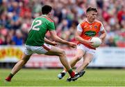 29 June 2019; Aidan Nugent of Armagh in action against Mikey Murray of Mayo during the GAA Football All-Ireland Senior Championship Round 3 match between Mayo and Armagh at Elverys MacHale Park in Castlebar, Mayo. Photo by Ben McShane/Sportsfile