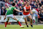 29 June 2019; Jamie Clarke of Armagh in action against Conor Loftus of Mayo during the GAA Football All-Ireland Senior Championship Round 3 match between Mayo and Armagh at Elverys MacHale Park in Castlebar, Mayo. Photo by Ben McShane/Sportsfile
