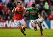 29 June 2019; Kevin McLoughlin of Mayo in action against Mark Shields of Armagh during the GAA Football All-Ireland Senior Championship Round 3 match between Mayo and Armagh at Elverys MacHale Park in Castlebar, Mayo. Photo by Ben McShane/Sportsfile