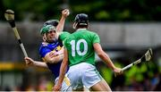 30 June 2019; John O'Dwyer of Tipperary is tackled by Declan Hannon, behind, and Gearóid Hegarty of Limerick during the Munster GAA Hurling Senior Championship Final match between Limerick and Tipperary at LIT Gaelic Grounds in Limerick. Photo by Piaras Ó Mídheach/Sportsfile
