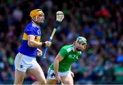 30 June 2019; Séamus Callanan of Tipperary in action against Seán Finn of Limerick during the Munster GAA Hurling Senior Championship Final match between Limerick and Tipperary at LIT Gaelic Grounds in Limerick. Photo by Piaras Ó Mídheach/Sportsfile