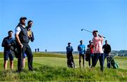 3 July 2019; Limerick hurler Cian Lynch, watched by Shane Lowry of Ireland, plays from the rough on the 2nd hole during the Pro-Am round ahead of the Dubai Duty Free Irish Open at Lahinch Golf Club in Lahinch, Co. Clare. Photo by Ramsey Cardy/Sportsfile