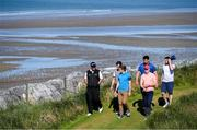 3 July 2019; Shane Lowry, left, of Ireland makes his way to the 7th tee box with Clare hurler Shane O'Donnell, centre, and Limerick hurler Cian Lynch during the Pro-Am round ahead of the Dubai Duty Free Irish Open at Lahinch Golf Club in Lahinch, Co. Clare. Photo by Ramsey Cardy/Sportsfile