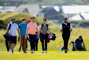 3 July 2019; Shane Lowry, right, of Ireland  with Limerick hurler Cian Lynch, centre, and Clare hurler Shane O'Donnell during the Pro-Am round ahead of the Dubai Duty Free Irish Open at Lahinch Golf Club in Lahinch, Co. Clare. Photo by Ramsey Cardy/Sportsfile