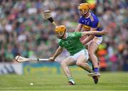 30 June 2019; Richie English of Limerick in action against Ronan Maher of Tipperary during the Munster GAA Hurling Senior Championship Final match between Limerick and Tipperary at LIT Gaelic Grounds in Limerick. Photo by Piaras Ó Mídheach/Sportsfile