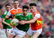 29 June 2019; Ciaran Tracey of Mayo is tackled by Aidan Nugent of Armagh during the GAA Football All-Ireland Senior Championship Round 3 match between Mayo and Armagh at Elverys MacHale Park in Castlebar, Mayo. Photo by Brendan Moran/Sportsfile