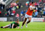29 June 2019; Stefan Campbell of Armagh in action against Donal Vaughan of Mayo during the GAA Football All-Ireland Senior Championship Round 3 match between Mayo and Armagh at Elverys MacHale Park in Castlebar, Mayo. Photo by Brendan Moran/Sportsfile