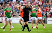 29 June 2019; Referee Maurice Deegan signals for fans to get off the pitch before the final whistle during the GAA Football All-Ireland Senior Championship Round 3 match between Mayo and Armagh at Elverys MacHale Park in Castlebar, Mayo. Photo by Brendan Moran/Sportsfile