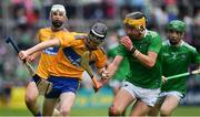 30 June 2019; Sean Ronan of Clare in action against Colin Coughlan of Limerick during the Electric Ireland Munster GAA Hurling Minor Championship Final match between Limerick and Clare at LIT Gaelic Grounds in Limerick. Photo by Brendan Moran/Sportsfile