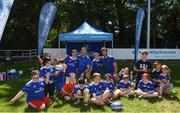 3 July 2019; Leinster players Caelan Doris and Josh Murphy with participants during the Bank of Ireland Leinster Rugby Summer Camp at Terenure RFC in Terenure, Dublin. Photo by Harry Murphy/Sportsfile