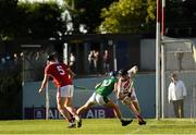 3 July 2019; Ger Collins of Cork in action against Paul O'Riordan of Limerick during the Bord Gais Energy Munster GAA Hurling Under 20 Championship Quarter-Final match between Cork and Limerick at Páirc Uí Rinn in Cork. Photo by Eóin Noonan/Sportsfile