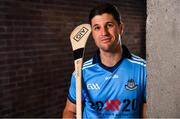 """4 July 2019; AIG Ireland announced today that the logo of the 20x20 campaign will replace their logo on the front of the Dublin GAA jersey for upcoming ladies' football, camogie, football & hurling fixtures. David Treacy of Dublin was at the launch today to help promote awareness of this """"If She Can't See It, She Can't Be It"""" initiative, designed to shift Ireland's cultural perception of women's sport by increasing media coverage, participation & attendance in women's sport by 20% by the year 2020. Photo by Sam Barnes/Sportsfile"""