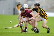 4 July 2019; Mark Kennedy of Galway in action against Michael Carey and Mikey Butler of Kilkenny during the Bord Gais Energy Leinster GAA Hurling U20 Championship semi-final match between Galway and Kilkenny at Bord na Mona O'Connor Park in Tullamore, Offaly. Photo by Matt Browne/Sportsfile