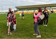 4 July 2019; Tina Ruane from Oranmore, Co. Galway takes a picture of her kids Stephen, age 10, Sarah, age 8, and Anna, age 12, with Kilkenny manager DJ Carey after the Bord Gais Energy Leinster GAA Hurling U20 Championship semi-final match between Galway and Kilkenny at Bord na Mona O'Connor Park in Tullamore, Offaly. Photo by Matt Browne/Sportsfile