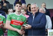 5 July 2019; Ethan Henry of Mayo is presented with his Electric Ireland Man of the Match award by Kevin Molloy, Electric Ireland, following the Electric Ireland Connacht GAA Football Minor Championship Final match between Galway and Mayo at Tuam Stadium in Tuam, Galway. Photo by Matt Browne/Sportsfile