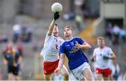 6 July 2019; Aidan Clarke of Tyrone in action against Cormac O'Reilly of Cavan during the EirGrid Ulster GAA Football U20 Championship semi-final match between Cavan and Tyrone at St. Tiernach's Park in Clones, Monaghan. Photo by Ben McShane/Sportsfile