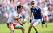 6 July 2019; Darragh Canavan of Tyrone in action against Cormac Donoghue of Cavan during the EirGrid Ulster GAA Football U20 Championship semi-final match between Cavan and Tyrone at St. Tiernach's Park in Clones, Monaghan. Photo by Oliver McVeigh/Sportsfile