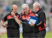 2 June 2013; Derry manager Brian McIver, centre, with trainer Paddy Tall, left, and selector Bernie Henry. Ulster GAA Football Senior Championship, Quarter-Final, Derry v Down, Celtic Park, Derry. Picture credit: Oliver McVeigh / SPORTSFILE