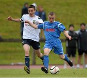 14 June 2013; Michael Cregan, DDSL, in action against Warren O'Hora, NDSL. 2013 SFAI Umbro Kennedy Cup Final, DDSL v NDSL, UL Arena, University of Limerick, Limerick. Picture credit: Brian Lawless / SPORTSFILE