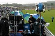 15 June 2013; RTE presenter, and former Sligo footballer, Eamonn O'Hara takes cover during the pre match commentary. Leinster GAA Football Senior Championship Quarter-Final, Wicklow v Meath, County Grounds, Aughrim, Co. Wicklow. Picture credit: Matt Browne / SPORTSFILE