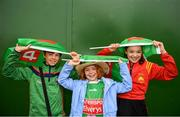 6 July 2019; Mayo supporters, from left, Cian, age 11, Amalie, age 9 and Sofia Corley Clark, age 12, take shelter from the rain ahead of the GAA Football All-Ireland Senior Championship Round 4 match between Galway and Mayo at the LIT Gaelic Grounds in Limerick. Photo by Eóin Noonan/Sportsfile