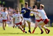 6 July 2019; Dara McVeety of Cavan in action against Tyrone players, from left, Ronan McNamee, Colm Cavanagh, and Hugh Pat McGeary during the GAA Football All-Ireland Senior Championship Round 4 match between Cavan and Tyrone at St. Tiernach's Park in Clones, Monaghan. Photo by Ben McShane/Sportsfile
