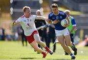 6 July 2019; Conor Madden of Cavan in action against Hugh Pat McGeary of Tyrone during the GAA Football All-Ireland Senior Championship Round 4 match between Cavan and Tyrone at St. Tiernach's Park in Clones, Monaghan. Photo by Ben McShane/Sportsfile