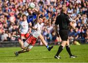 6 July 2019; Matthew Donnelly of Tyrone in action against Ciaran Brady of Cavan during the GAA Football All-Ireland Senior Championship Round 4 match between Cavan and Tyrone at St. Tiernach's Park in Clones, Monaghan. Photo by Oliver McVeigh/Sportsfile