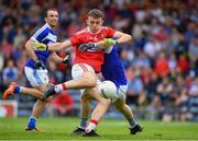 6 July 2019; Mark Collins of Cork scores the third goal past Laois defender Trevor Collins during the GAA Football All-Ireland Senior Championship Round 4 match between Cork and Laois at Semple Stadium in Thurles, Tipperary. Photo by Matt Browne/Sportsfile