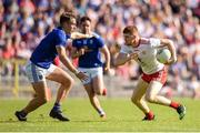 6 July 2019; Cathal McShane of Tyrone in action against Pádraig Faulkner of Cavan during the GAA Football All-Ireland Senior Championship Round 4 match between Cavan and Tyrone at St. Tiernach's Park in Clones, Monaghan. Photo by Ben McShane/Sportsfile