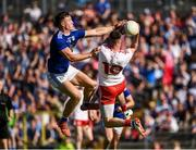 6 July 2019; Matthew Donnelly of Tyrone in action against Conor Brady of Cavan during the GAA Football All-Ireland Senior Championship Round 4 match between Cavan and Tyrone at St.Tiernach's Park in Clones, Monaghan. Photo by Oliver McVeigh/Sportsfile