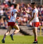 6 July 2019; Ben McDonnell of Tyrone celebrates after scoring his side's first goal with team-mate Richard Donnelly during the GAA Football All-Ireland Senior Championship Round 4 match between Cavan and Tyrone at St. Tiernach's Park in Clones, Monaghan. Photo by Ben McShane/Sportsfile
