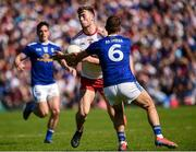 6 July 2019; Brian Kennedy of Tyrone in action against Killian Clarke of Cavan during the GAA Football All-Ireland Senior Championship Round 4 match between Cavan and Tyrone at St.Tiernach's Park in Clones, Monaghan. Photo by Oliver McVeigh/Sportsfile