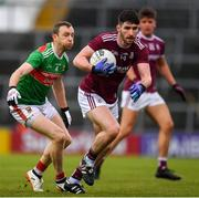 6 July 2019; Martin Farragher of Galway in action against Keith Higgins of Mayo during the GAA Football All-Ireland Senior Championship Round 4 match between Galway and Mayo at the LIT Gaelic Grounds in Limerick. Photo by Brendan Moran/Sportsfile
