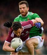 6 July 2019; Ian Burke of Galway is tackled by Chris Barrett of Mayo during the GAA Football All-Ireland Senior Championship Round 4 match between Galway and Mayo at the LIT Gaelic Grounds in Limerick. Photo by Brendan Moran/Sportsfile