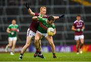 6 July 2019; Darren Coen of Mayo in action against Declan Kyne of Galway during the GAA Football All-Ireland Senior Championship Round 4 match between Galway and Mayo at the LIT Gaelic Grounds in Limerick. Photo by Eóin Noonan/Sportsfile