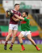 6 July 2019; Eamonn Brannigan of Galway in action against Kevin McLoughlin of Mayo during the GAA Football All-Ireland Senior Championship Round 4 match between Galway and Mayo at the LIT Gaelic Grounds in Limerick. Photo by Eóin Noonan/Sportsfile