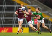 6 July 2019; Aintaine Ó Laoi of Galway in action against Kevin McLoughlin of Mayo during the GAA Football All-Ireland Senior Championship Round 4 match between Galway and Mayo at the LIT Gaelic Grounds in Limerick. Photo by Eóin Noonan/Sportsfile