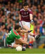 6 July 2019; Ian Burke of Galway is fouled by Chris Barrett of Mayo resulting in a penalty during the GAA Football All-Ireland Senior Championship Round 4 match between Galway and Mayo at the LIT Gaelic Grounds in Limerick. Photo by Eóin Noonan/Sportsfile