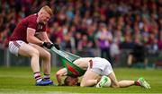6 July 2019; Sean Andy Ó Ceallaigh of Galway pulls the jersey of Colm Boyle of Mayo during the GAA Football All-Ireland Senior Championship Round 4 match between Galway and Mayo at the LIT Gaelic Grounds in Limerick. Photo by Brendan Moran/Sportsfile