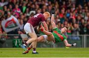 6 July 2019; Declan Kyne of Galway and Cillian O'Connor of Mayo during the GAA Football All-Ireland Senior Championship Round 4 match between Galway and Mayo at the LIT Gaelic Grounds in Limerick. Photo by Brendan Moran/Sportsfile