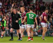 6 July 2019; Declan Kyne of Galway is shown a yellow card by referee Joe McQuillan during the GAA Football All-Ireland Senior Championship Round 4 match between Galway and Mayo at the LIT Gaelic Grounds in Limerick. Photo by Brendan Moran/Sportsfile