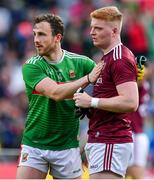 6 July 2019; Darren Coen of Mayo, left, with Sean Andy Ó Ceallaigh of Galway after the GAA Football All-Ireland Senior Championship Round 4 match between Galway and Mayo at the LIT Gaelic Grounds in Limerick. Photo by Brendan Moran/Sportsfile