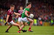 6 July 2019; Cillian O'Connor of Mayo in action against Johnny Heaney of Galway during the GAA Football All-Ireland Senior Championship Round 4 match between Galway and Mayo at the LIT Gaelic Grounds in Limerick. Photo by Brendan Moran/Sportsfile