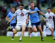 6 July 2019; Shane Flynn of Kildare shoots under pressure from Ryan O'Dwyer of Dublin during the Electric Ireland Leinster GAA Football Minor Championship Final match between Dublin and Kildare at Páirc Tailteann in Navan, Meath. Photo by Piaras Ó Mídheach/Sportsfile